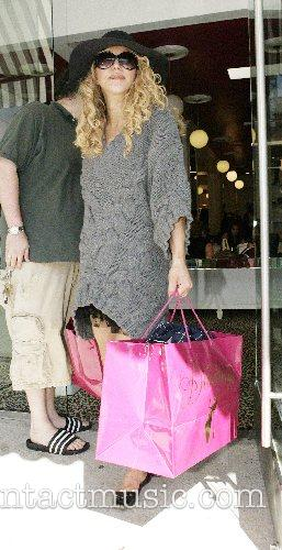 Courtney Love shops at the trendy Diavolina at...