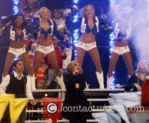 Kelly Clarkson performs with the Dallas Cowboy Cheerleaders...