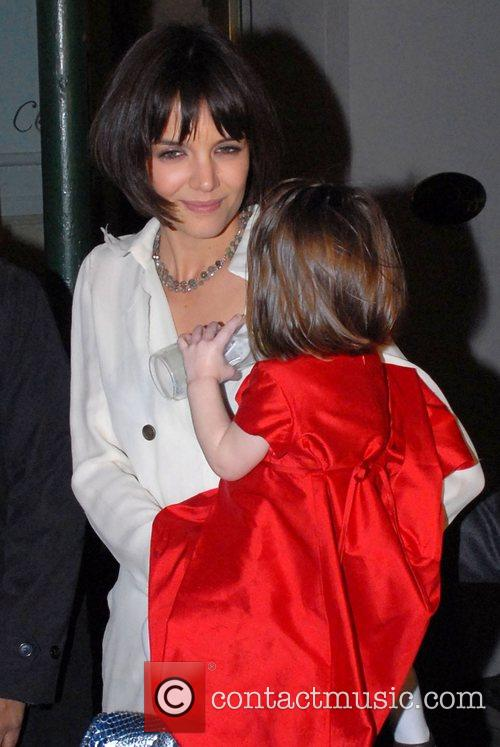 Katie Holmes, and daughter Suri Cruise leaving after...