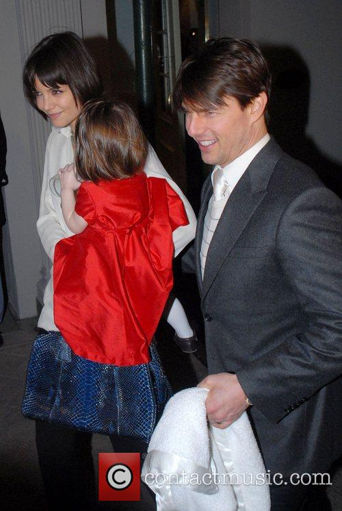 Tom Cruise, Katie Holmes, and daughter Suri Cruise...
