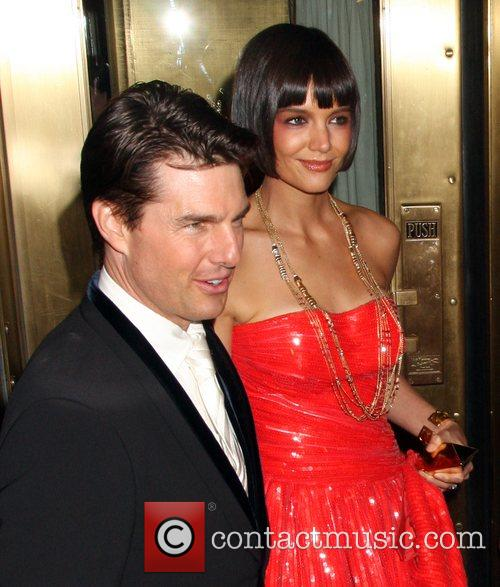 Tom Cruise and Katie Holmes leaving their hotel...