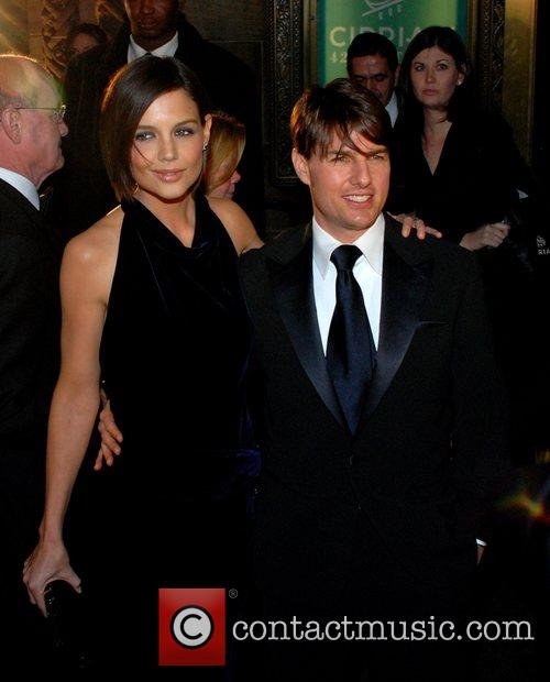 Tom Cruise and Katie Holmes attending Tom's black-tie...