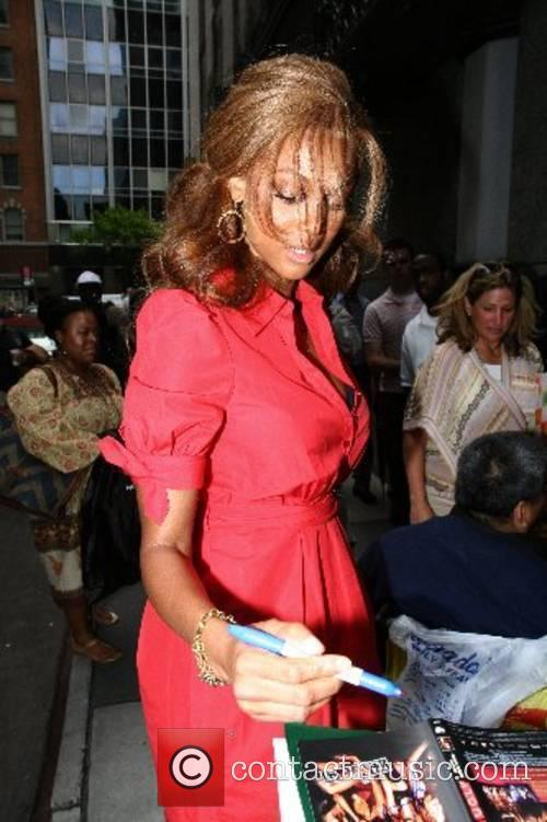 Tyra Banks signs autographs as she arrives at...