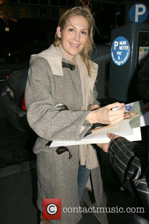 Signs autographs while arriving at the CW11 Morning...