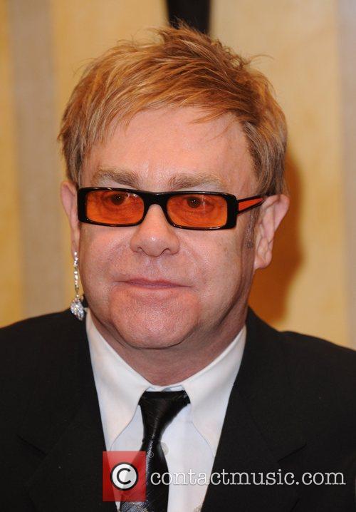 Elton John and David Beckham 3