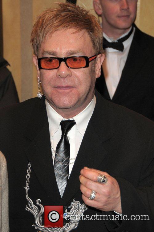 Elton John and David Beckham 8