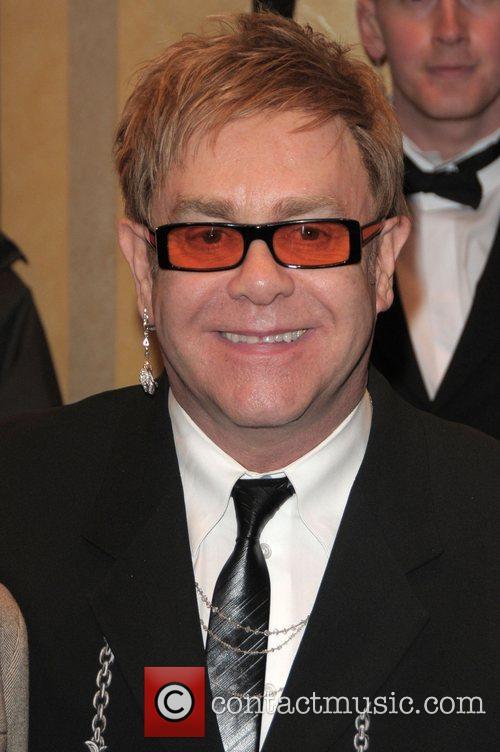 Elton John and David Beckham 6