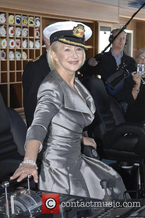 Dame Helen Mirren Wearing the captain's hat Takes...