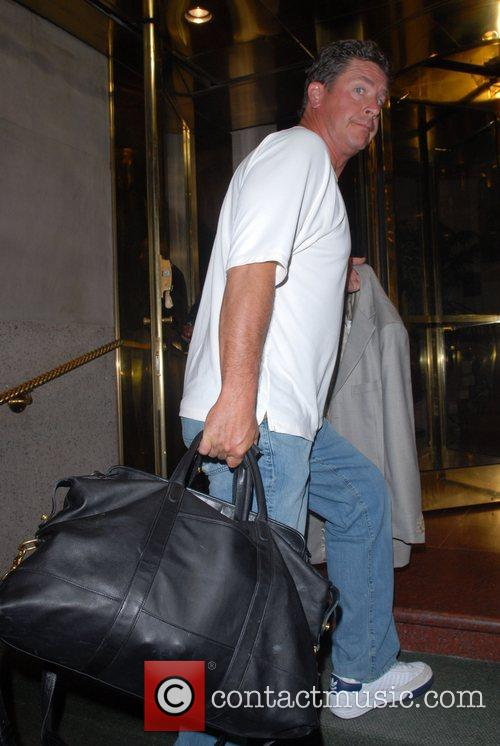 Arriving at his hotel, carrying a large luggage...