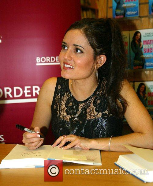 Danica McKellar signs copies of her new book...