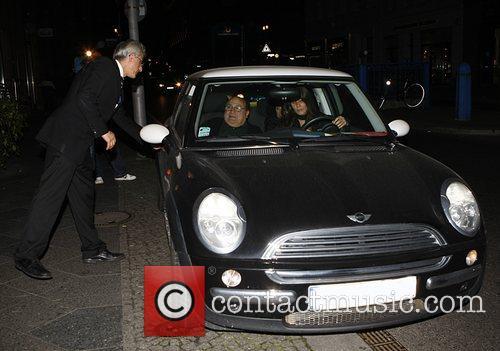 Danny DeVito in a Rover Mini car leaving...