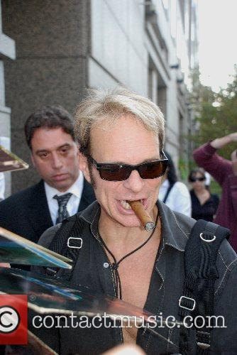 David Lee Roth  signs autographs as he...