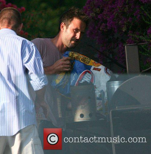 David Arquette tries to build a barbeque trying...
