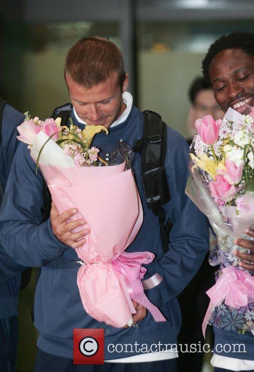 Soccer player David Beckham arrives with his team...