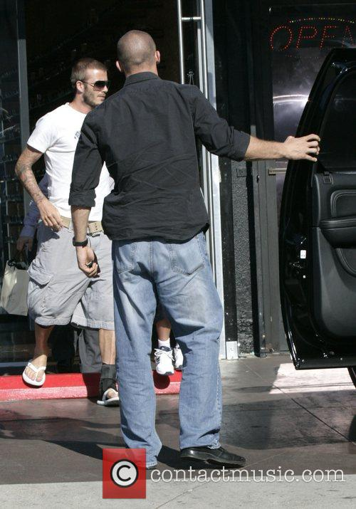 David Beckham and his son Brooklyn out shopping...