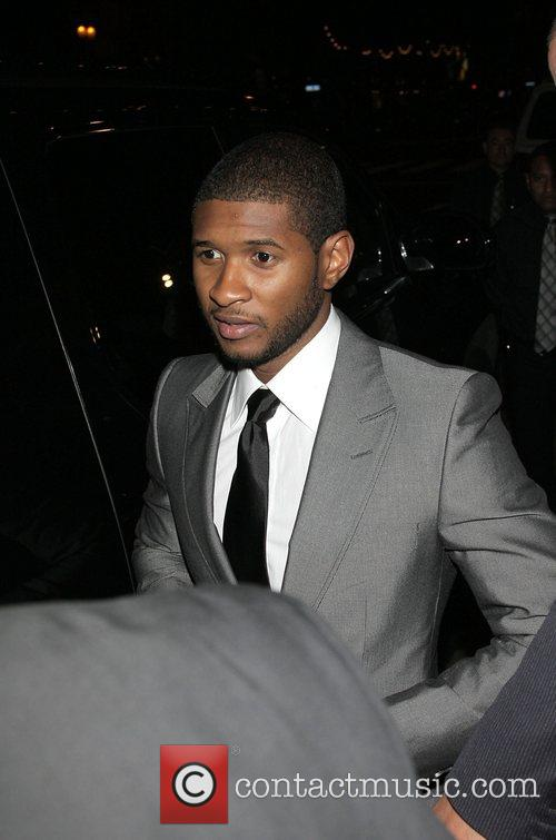 Usher Arriving at a party thrown by the...
