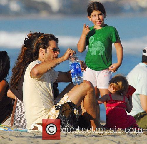 David Charvet with fiancee Brooke Burke and daughter...