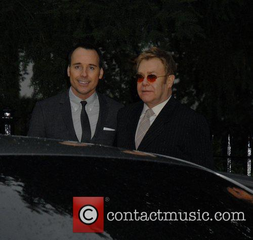 David Furnish and Elton John,  arrives at...