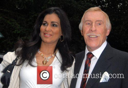Wilnelia Merced and Bruce Forsythe arriving at Sir...