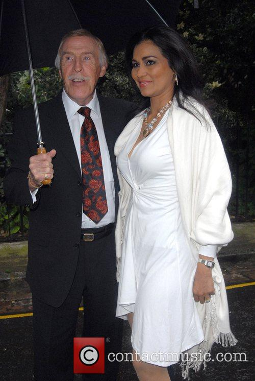 Bruce Forsythe and Wilnelia Merced arriving at Sir...