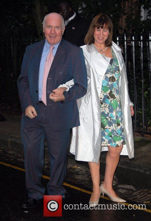 John Reid and guest arrive at Sir David...