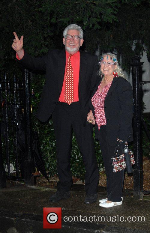 Rolf Harris and Alwen Harris arrive at Sir...