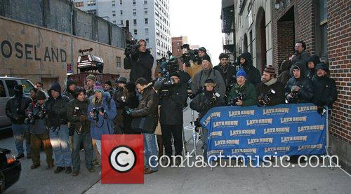 Photographers and journalists wait outside CBS studio for...