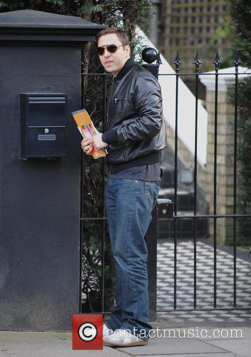 Collecting his post, perhaps checking if there is...