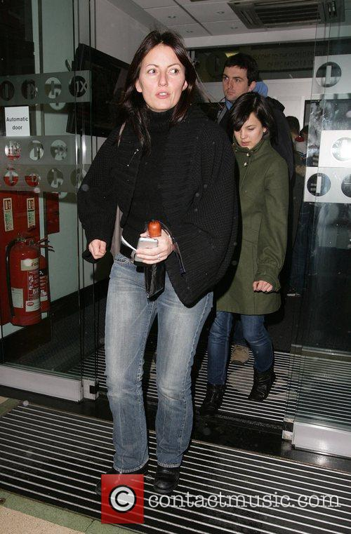 Davina McCall smiling for photographers when leaving the...