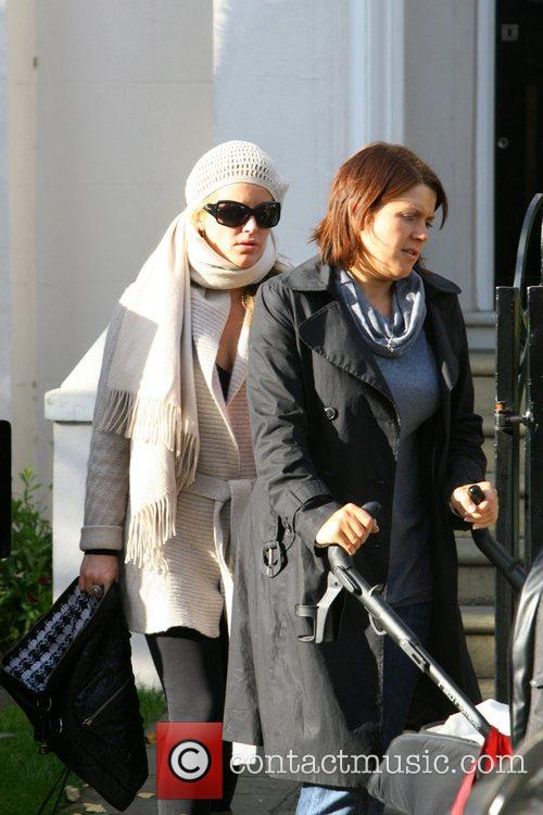Davinia Taylor leaves her house with her nanny...