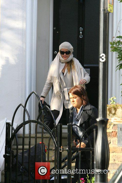 Leaves her house with her nanny and son...
