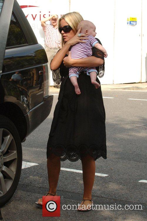 Davinia Taylor leaving her house with her baby...