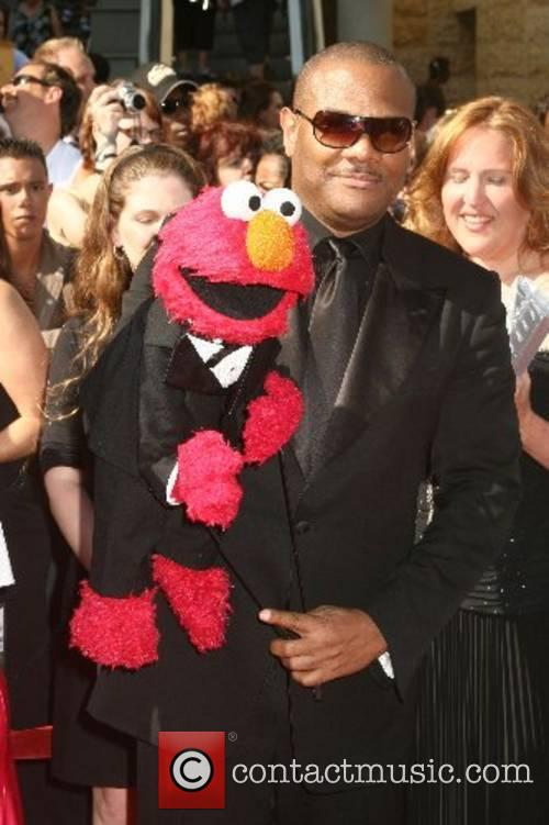 Elmo with his puppeteer Devin Clash 34th Annual...