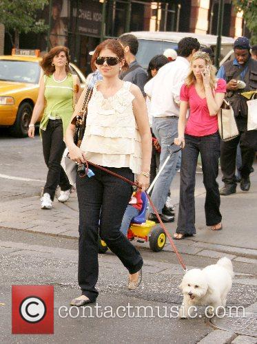 Debra Messing out and about enjoying the warm...