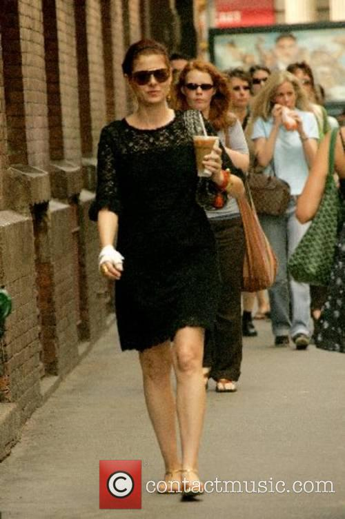 Debra Messing walking around in Soho New York...