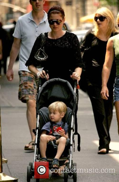 Debra Messing and son  walking around in...