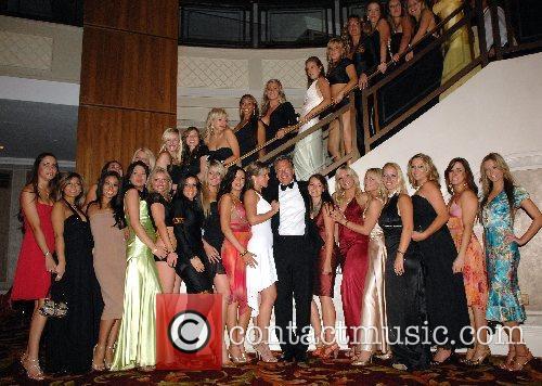 Michael Portillo with Spearmint Rhino girls Debra charity...