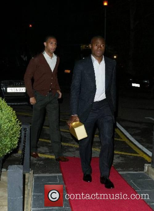 Anton Ferdinand, left and guest Engagement party for...