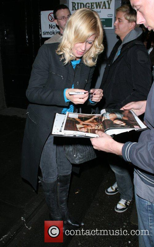 Denise Van Outen signs autographs, while leaving the...