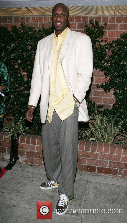 Lamar Odom Derek Fisher celebrates his return to...