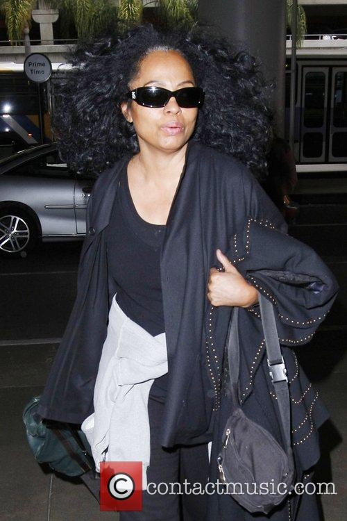 Diana Ross dressed in black arriving at LAX...