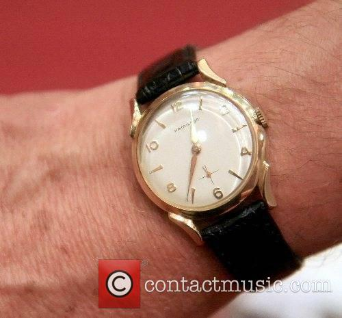Buddy holly the watch that was worn almost continuously by buddy holly a 14 carat gold for Celebrity rocks watches