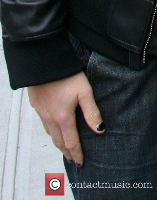 New York Rangers' Sean Avery wearing black nail...