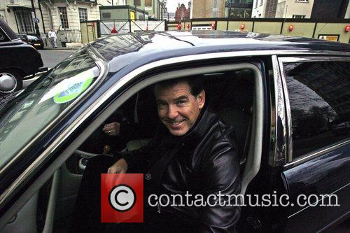 Pierce Brosnan getting into a minicab at the...