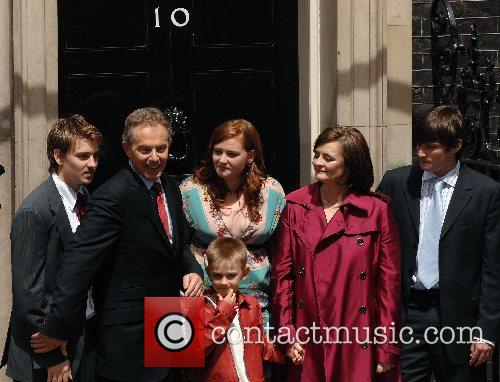 Tony Blair and his family pose at 10...