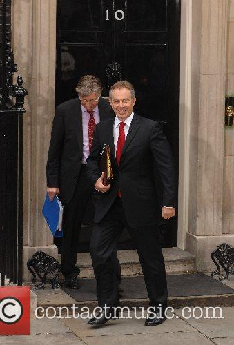 Leaving 10 Downing Street on his last day...