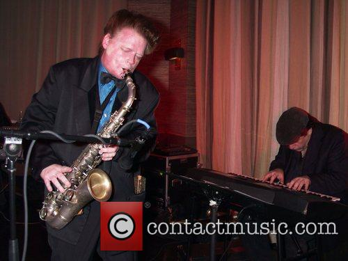 Performing at the 'Downtown 81' CD release party...