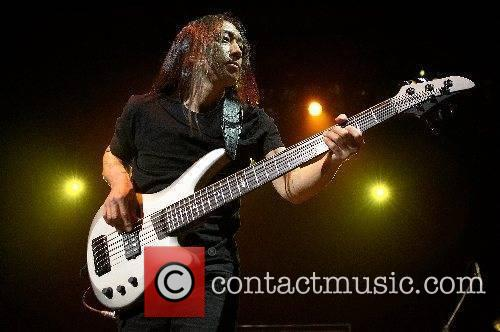 John Myung of Dream Theatre performing live at...