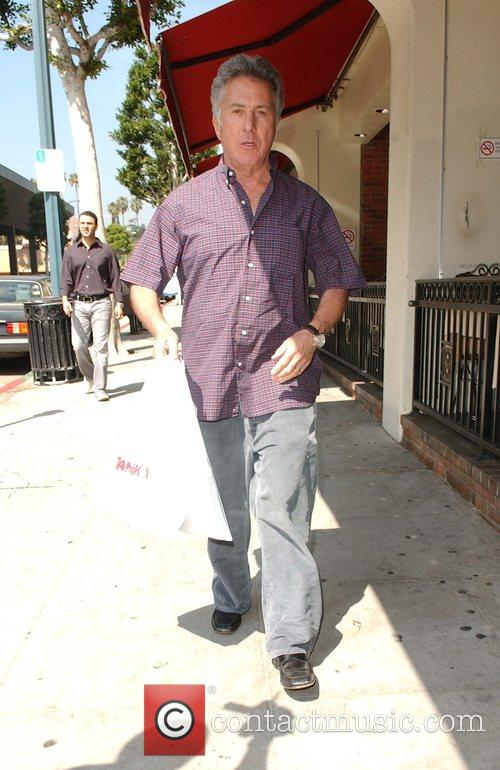 Out and about in Beverly Hills. He stopped...