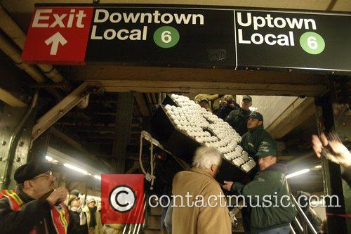 The giant number 8 arrives by subway train...